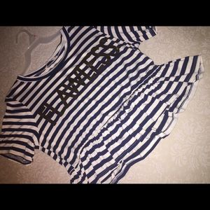 A cute navy and white striped shirt with ruffles